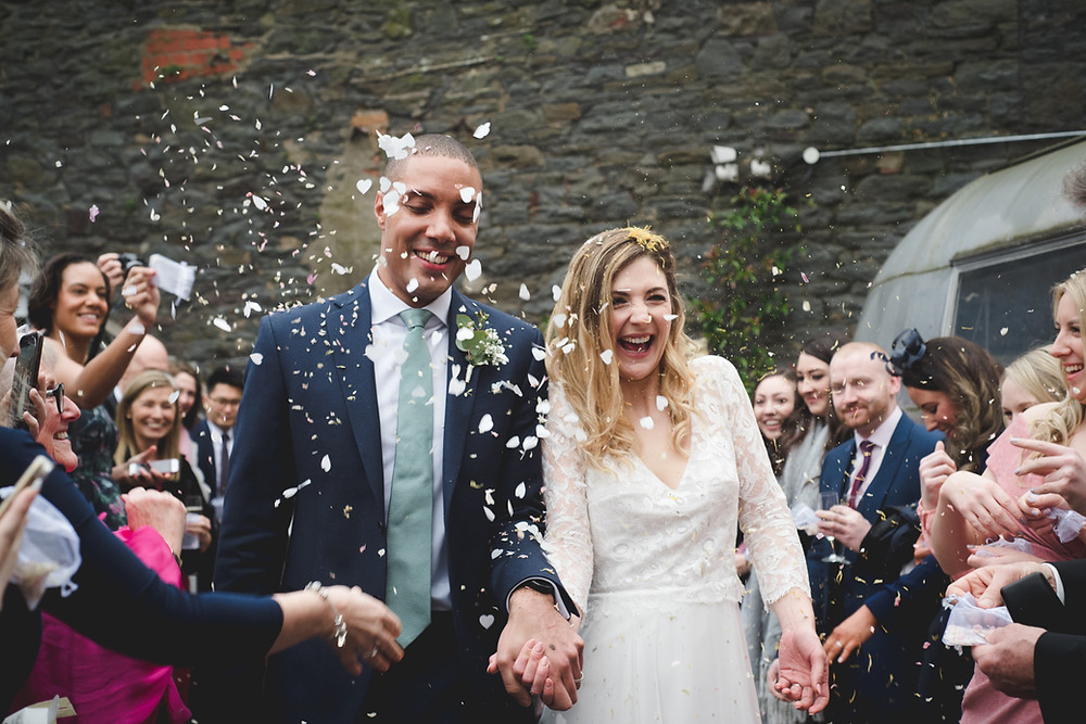 Bride & Groom getting confetti thrown on them at Paintworks in Bristol