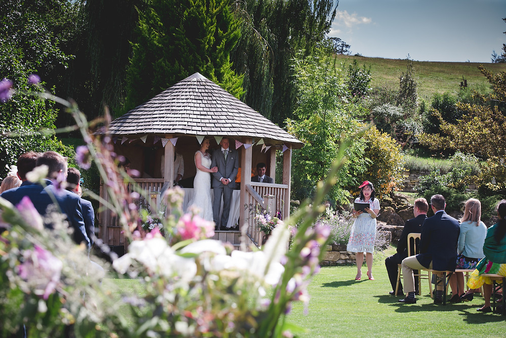 Reading during outdoor summer wedding ceremony at Deer Park Hall in Worcestershire