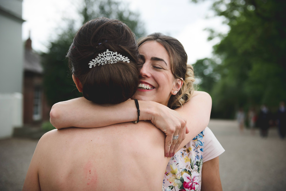 guest hugging bride at Somerford Hall wedding
