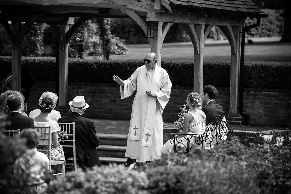 Photo-journalistic image of vicar conducting outdoor blessing at Wethele Manor