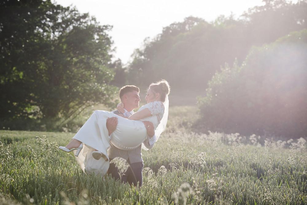Bride & Groom in field at sunset at Delbury Hall summer wedding