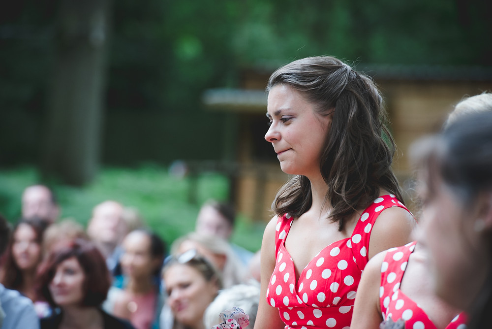 emotional bridesmaid in red polka dot dress
