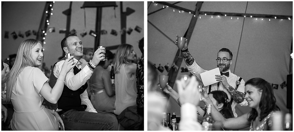 toast during speeches at tipi wedding - black & white image