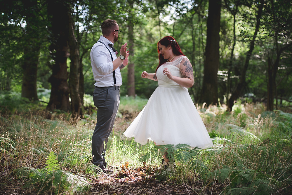 Outdoor wedding blessing in woodlands in Warwickshire
