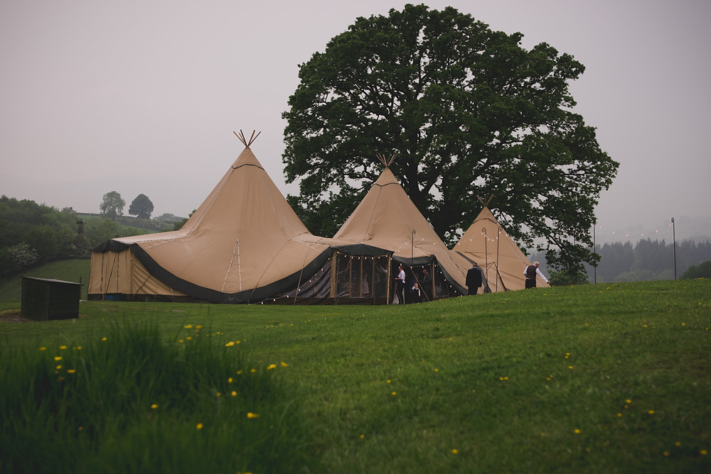 Sami Tipi in a field at The Bringewood Wedding venue