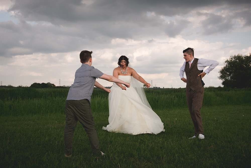 Bride being taught to do the floss dance at Cuttlebrook Farm wedding