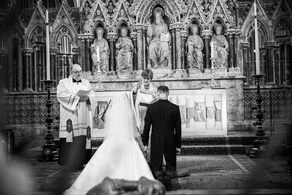 Bride & Groom receiving blessing at the alter at Worcester Cathedral
