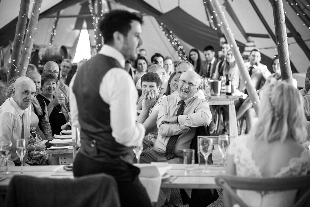 documentary wedding photography during speeches in a tipi