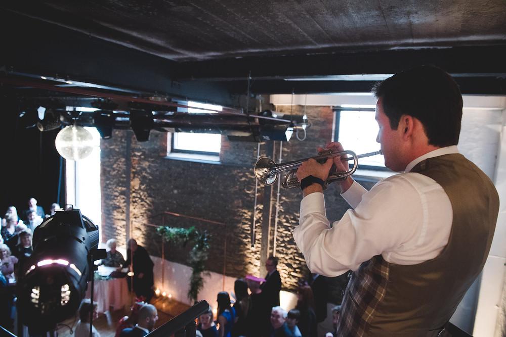 trumpet player during wedding ceremony at bristol paintworks