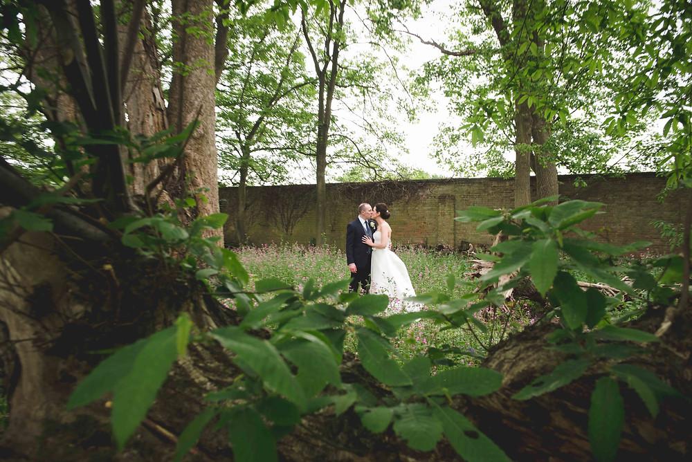 bride & groom in the garden at Somerford Hall wedding