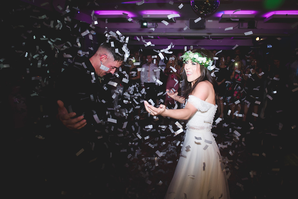 confetti cannons being fired on to dancefloor during first dance at birmingham penthouse wedding reception
