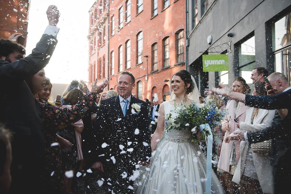 Bride & Groom doing the confetti run in Digbeth