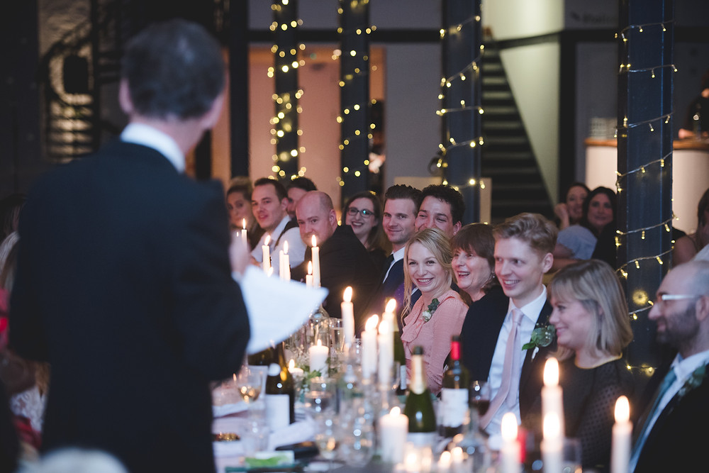 guests looking at father of bride as he gives his speech at bristol wedding