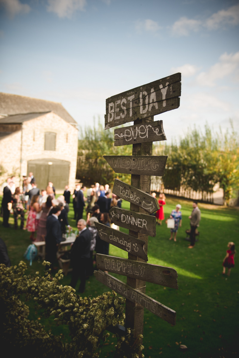 Wooden sign at Lyde court wedding near Hereford