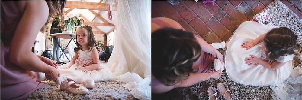 Flower girl being dressed before Hereford wedding