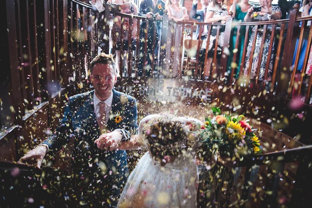 Bride rushing to her wedding at Grafton Manor