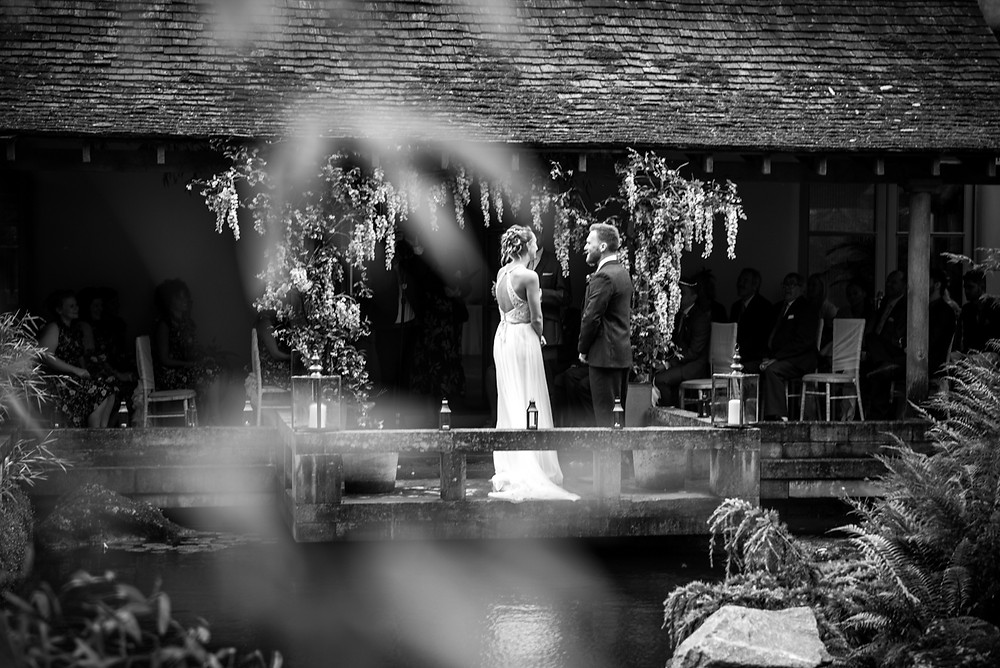 Bride & Groom in cloistered courtyard at Matara Centre in Gloucestershire