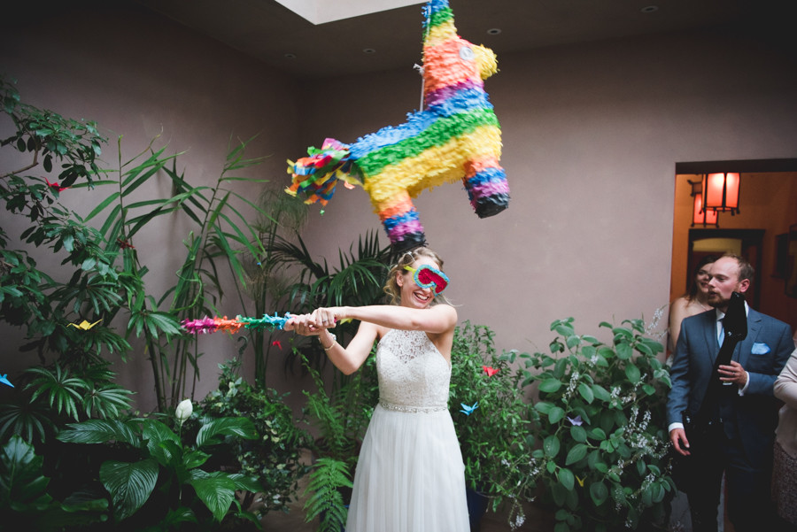 Bride playing pinata at Matara Centre wedding