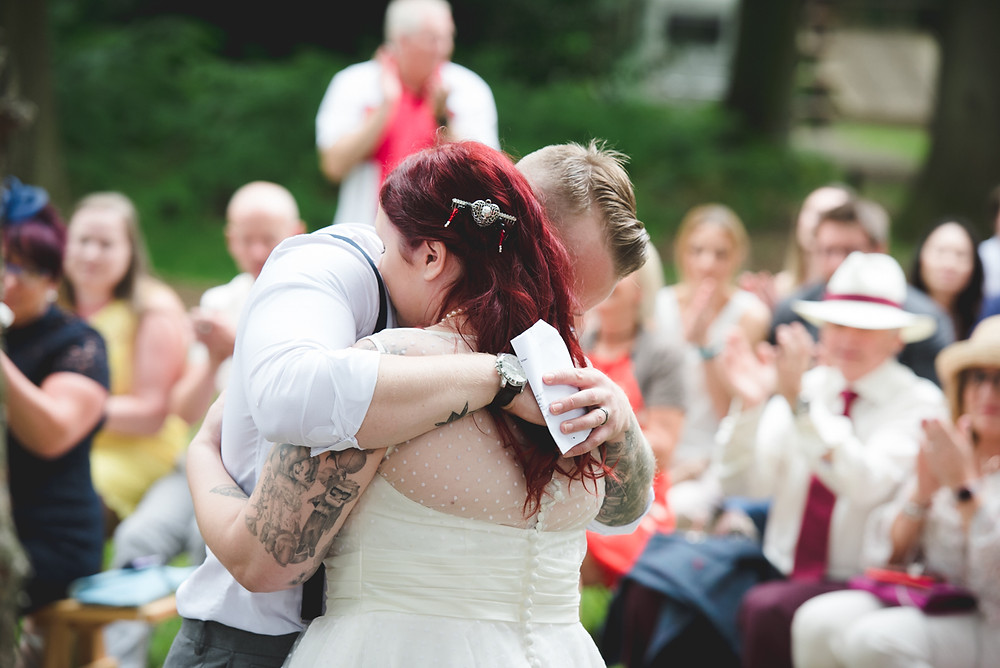 bride & groom hugging at umberslade adventure wedding
