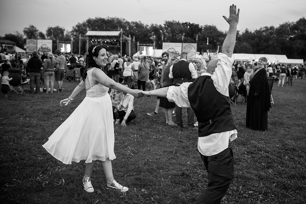 Bride & groom having their first dance at Sunshine Music Festival in Upton upon Severn