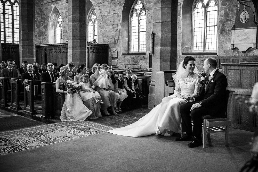 black and wedding ceremony photo at St Mark's church in Brewood