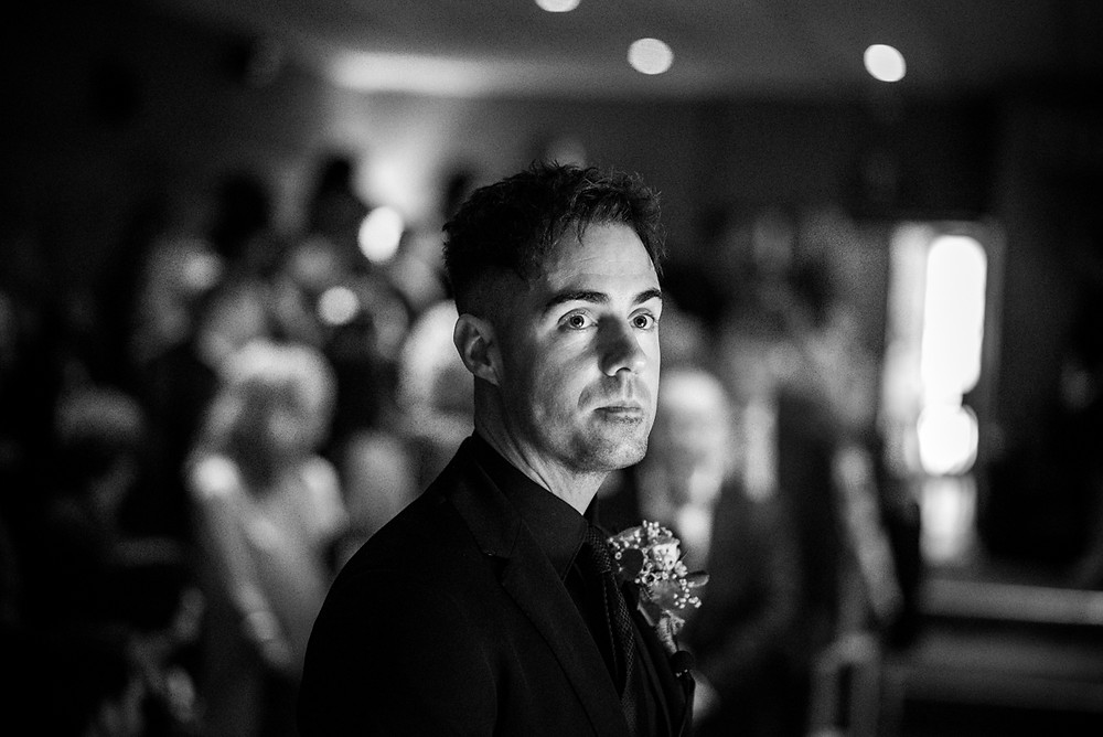 thoughtful looking groom, moments before his wedding at the electric cinema in birmingham