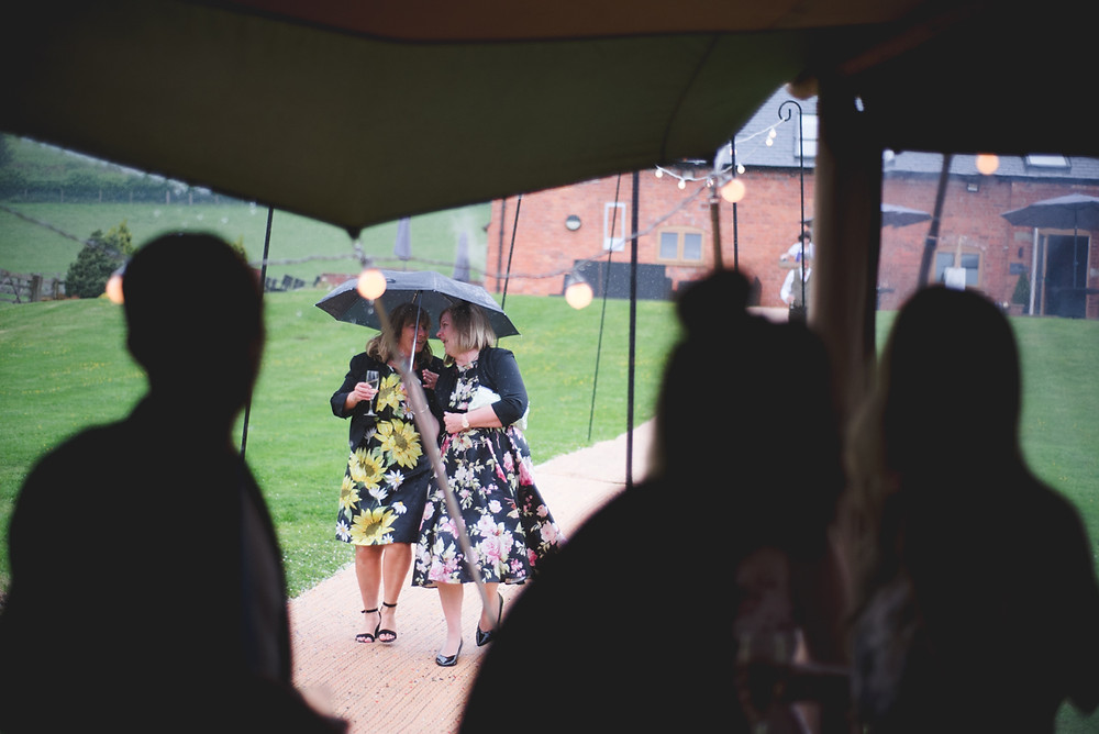 wedding guests in the rain at The Bringewood
