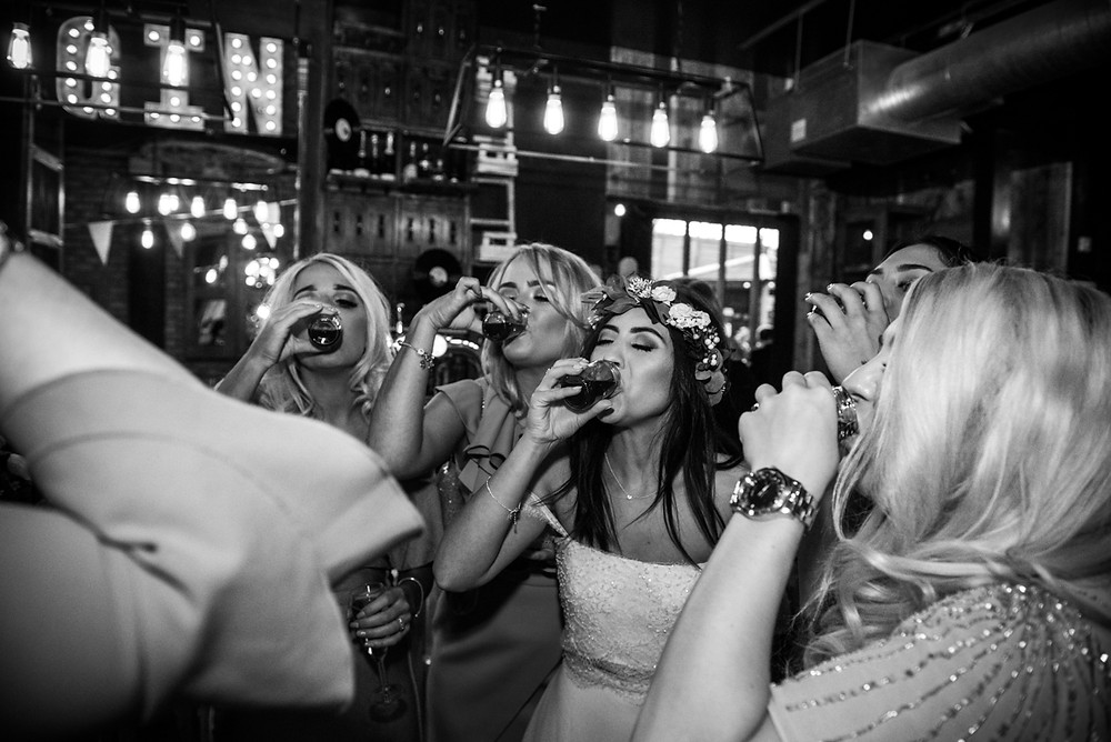 bride and her friends drinking jager bombs at Birmingham Loft wedding reception