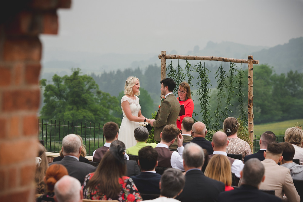 Outdoor wedding ceremony overlooking Welsh hills