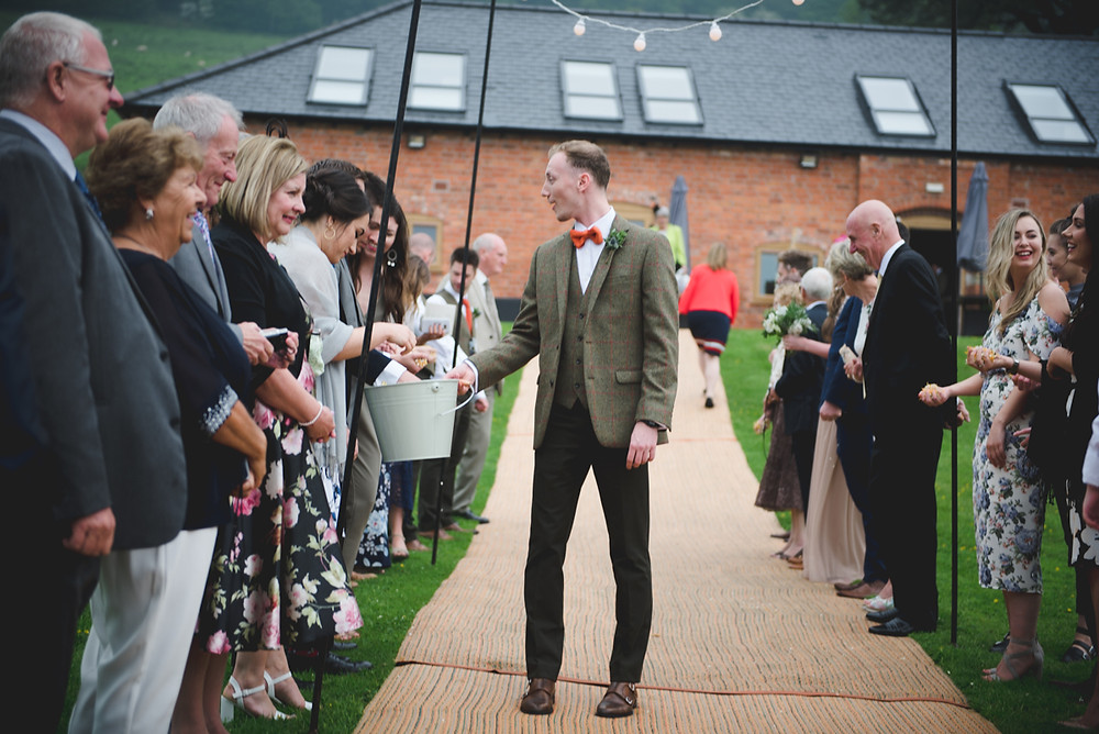 guests getting ready to throw confetti at Herefordshire wedding