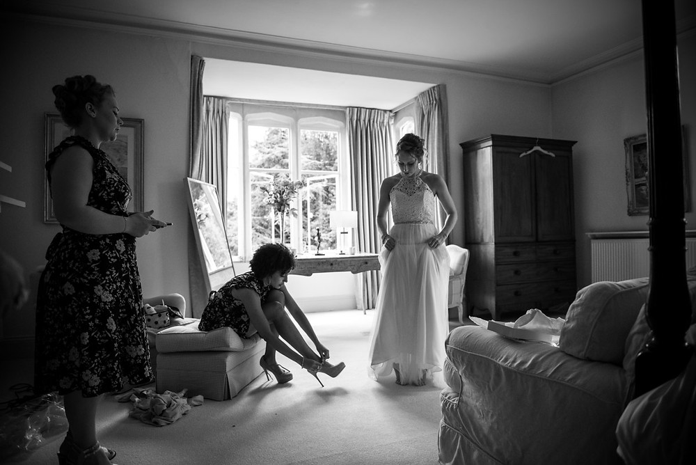 Candid wedding photography showing the bride getting ready at The Matara Centre