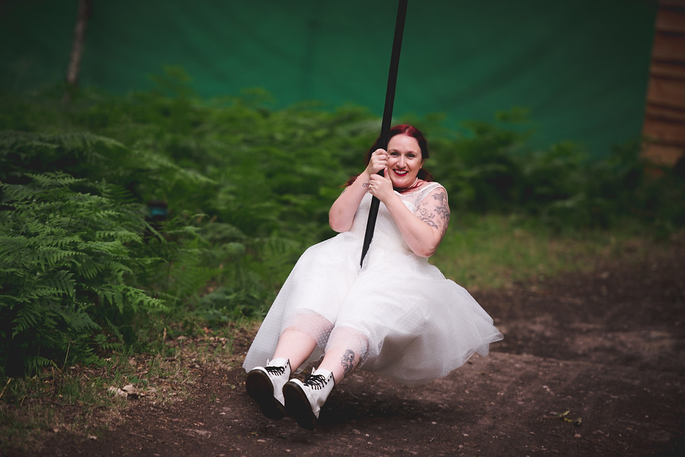 Bride on zipwire at her Enchanting Woodland Weddings big day