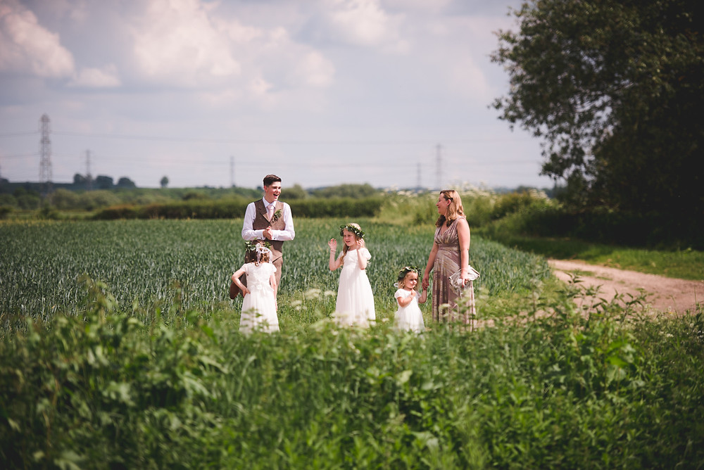 flower girls waiting in a field at Cuttlebrook Farm before bride arrives