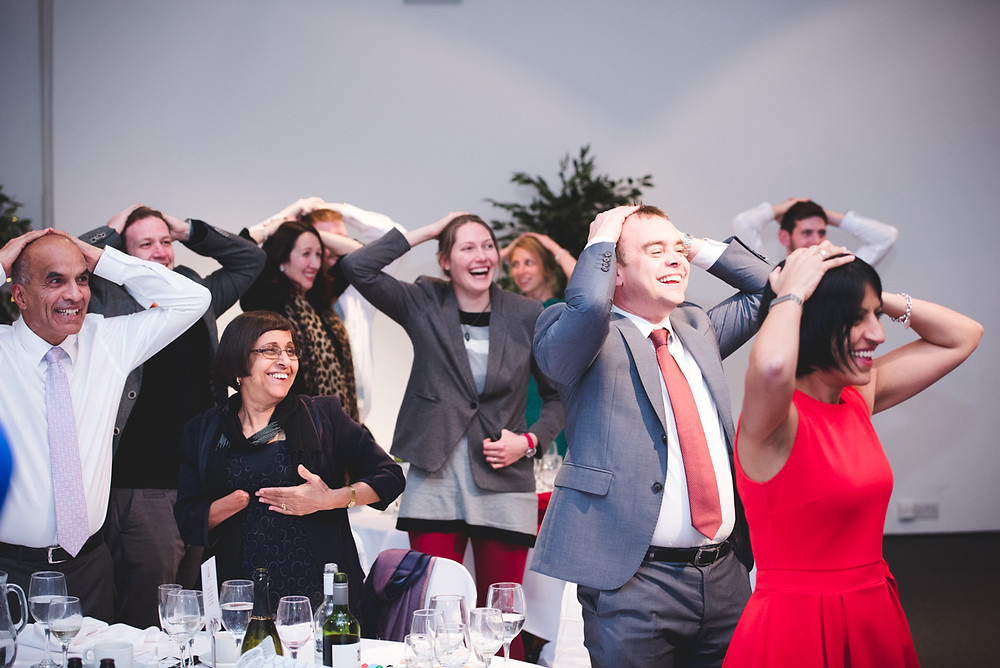 Guests having fun playing a party game at FazeleY studios wedding