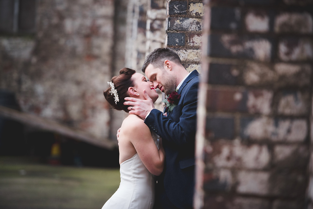 A passionate moment between the bride & groom after their wedding at the Bond Company in Digbeth