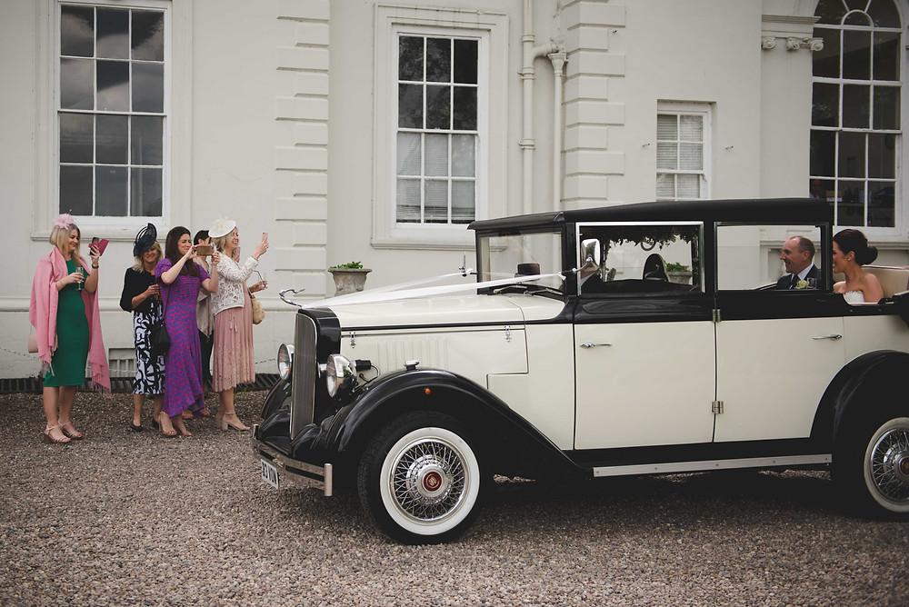 wedding car arriving at Somerford Hall