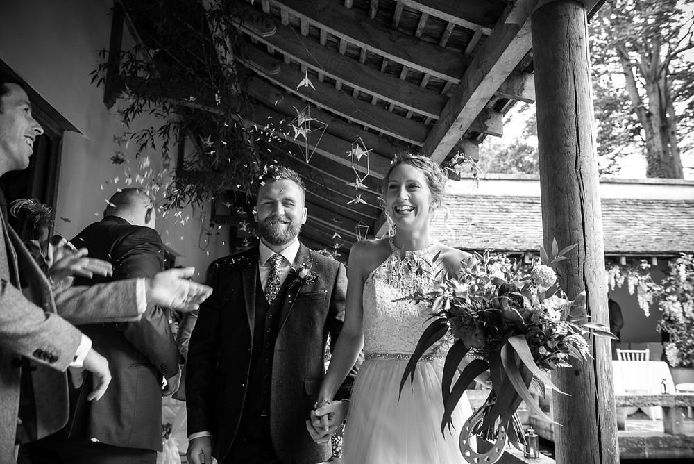 Bride & groom getting confetti thronw on them at Matara Centre wedding