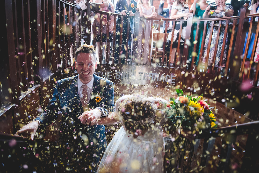 Confetti shower as Bride & Groom arrive at Birmingham Distillery for their wedding reception