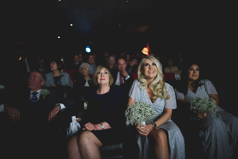 happy mother of the bride and bridesmaid watching wedding ceremony at Birmingham's electric cinema