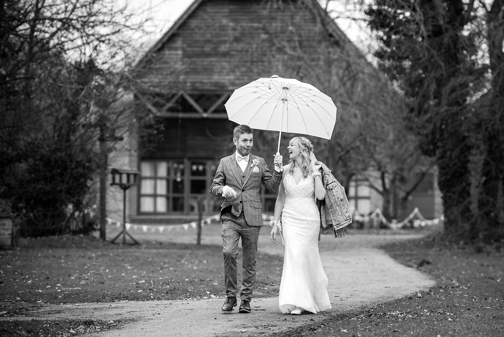 Unposed wedding photography of laughing bride & groom at their Avoncroft museum wedding