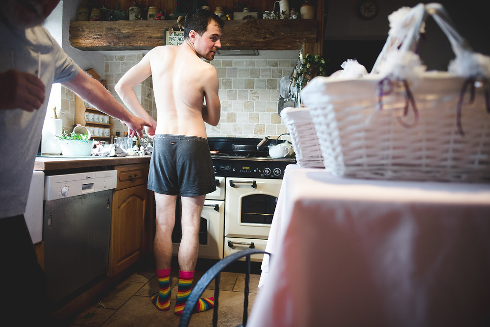 Groom in his boxer shorts getting ready for his Stanway House wedding