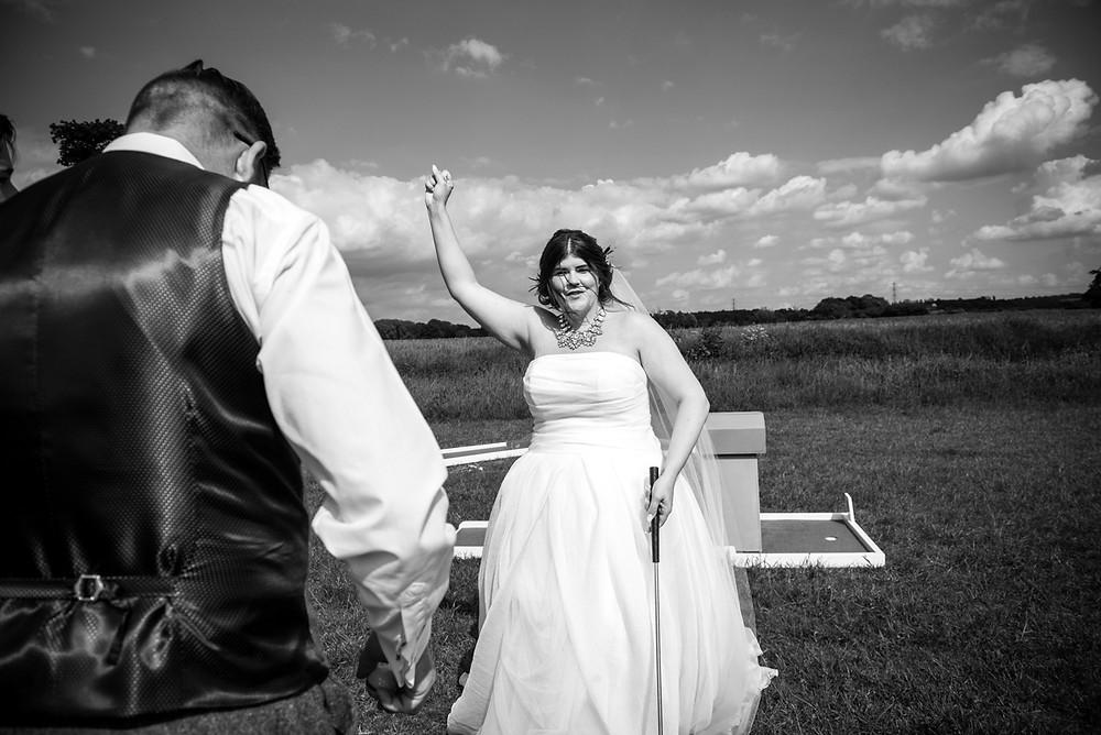 Bride at Derbyshire wedding celebrates after winning at crazy golf