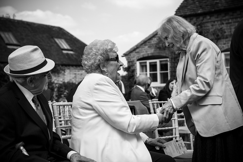 Two Grandmas saying hello at Warwickshire summer wedding