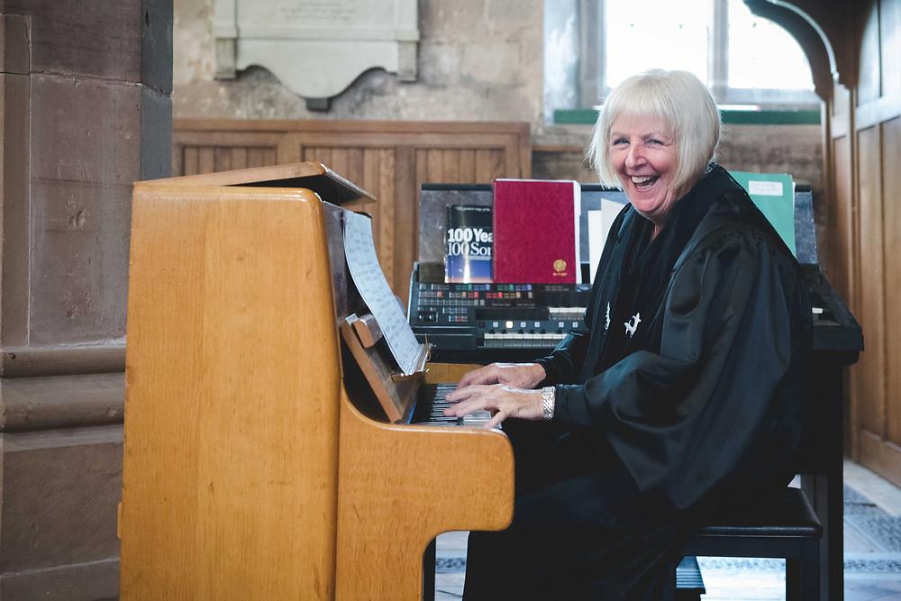 Jenny Martyn playing the piano at Brewood wedding
