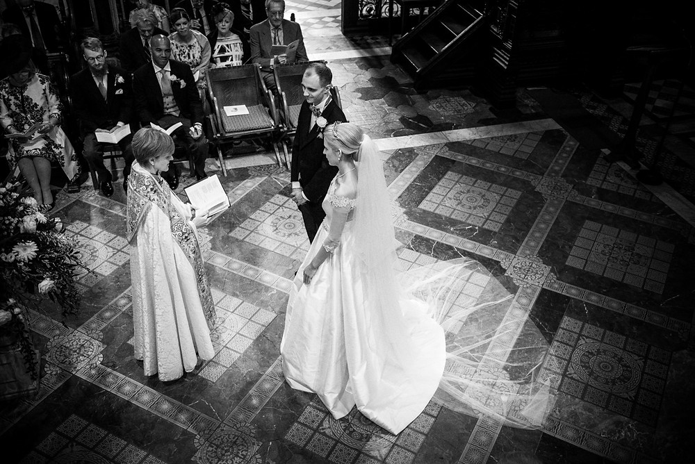 Bride & Groom during their wedding ceremony at Worcester Cathedral