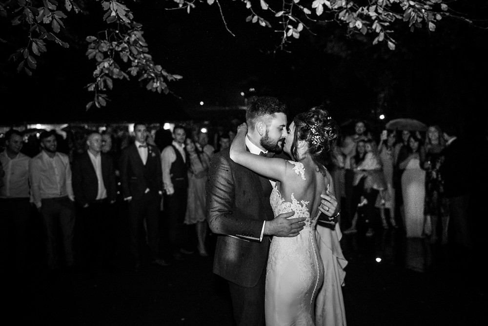 Bride & Groom having their first dance outside at their Moddershall Oaks wedding