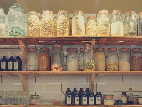 Stocking Food In A Pantry