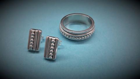 """Zilveren set met beweegbare """"spinner"""" ring"""