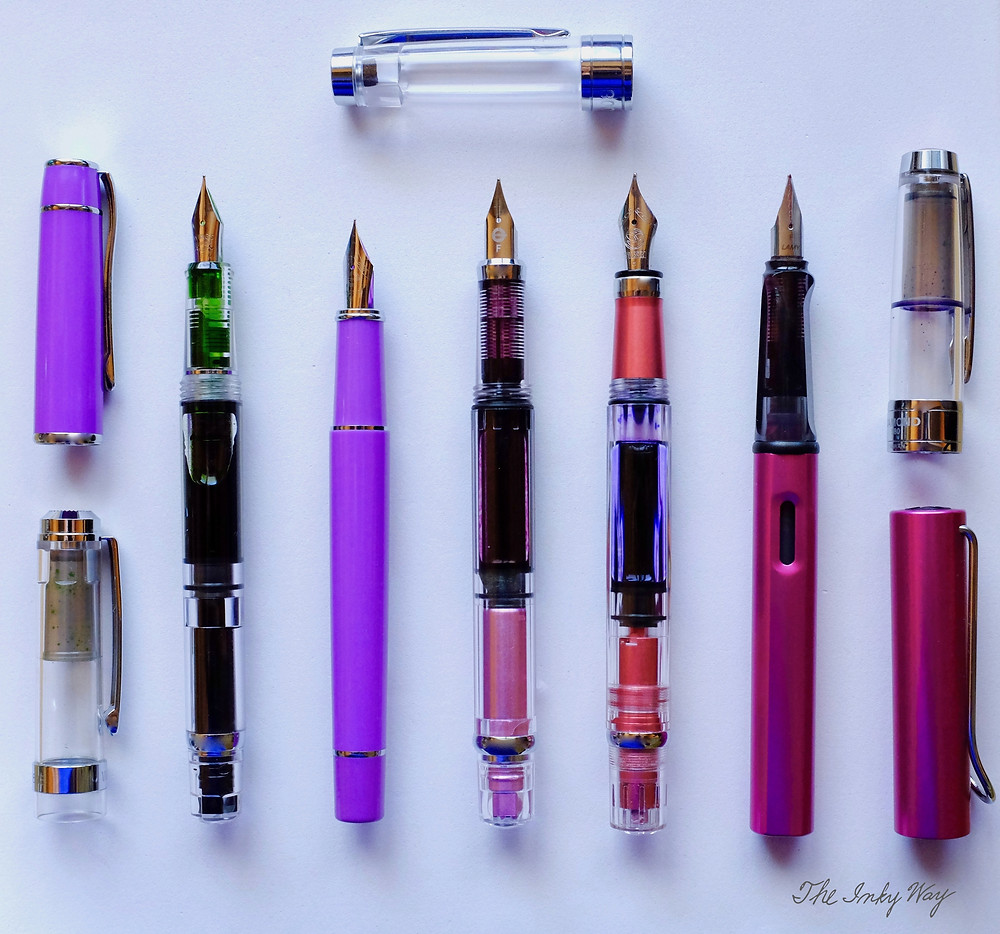 rom left to right, all uncapped: the Wing Sung 698, Wing Sung 3003, Wing Sung 3008, TWSBI Diamond 580 AL, and the Lamy Al-Star.