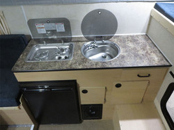 flat-bed-popup-truck-camper-full-sized-trucks-kitchen-sink-stove-furnace